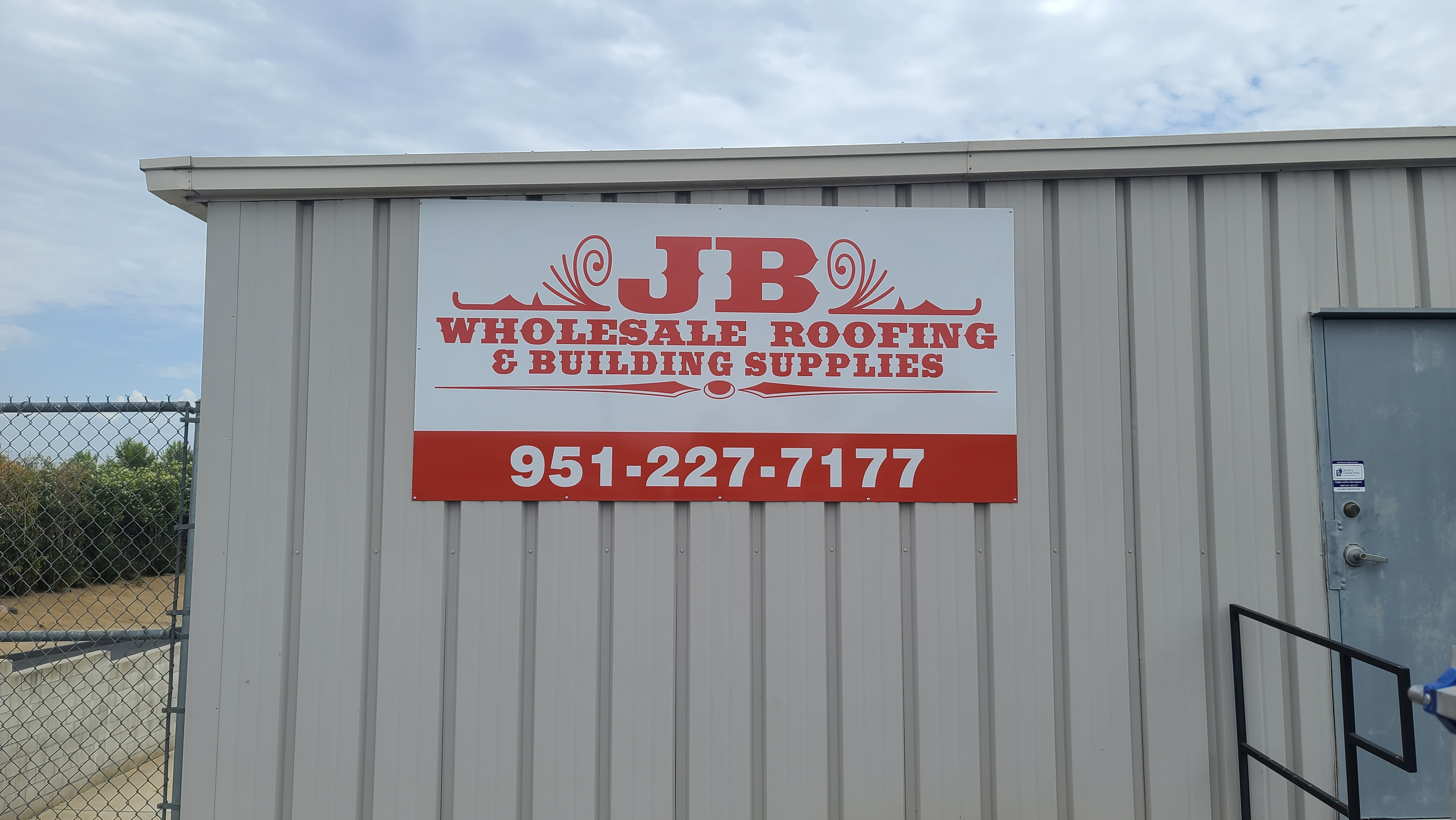 This metal panel sign for JB Wholesale Roofing's parking lot in Murietta features their logo and contact details, giving their brand more visibility.