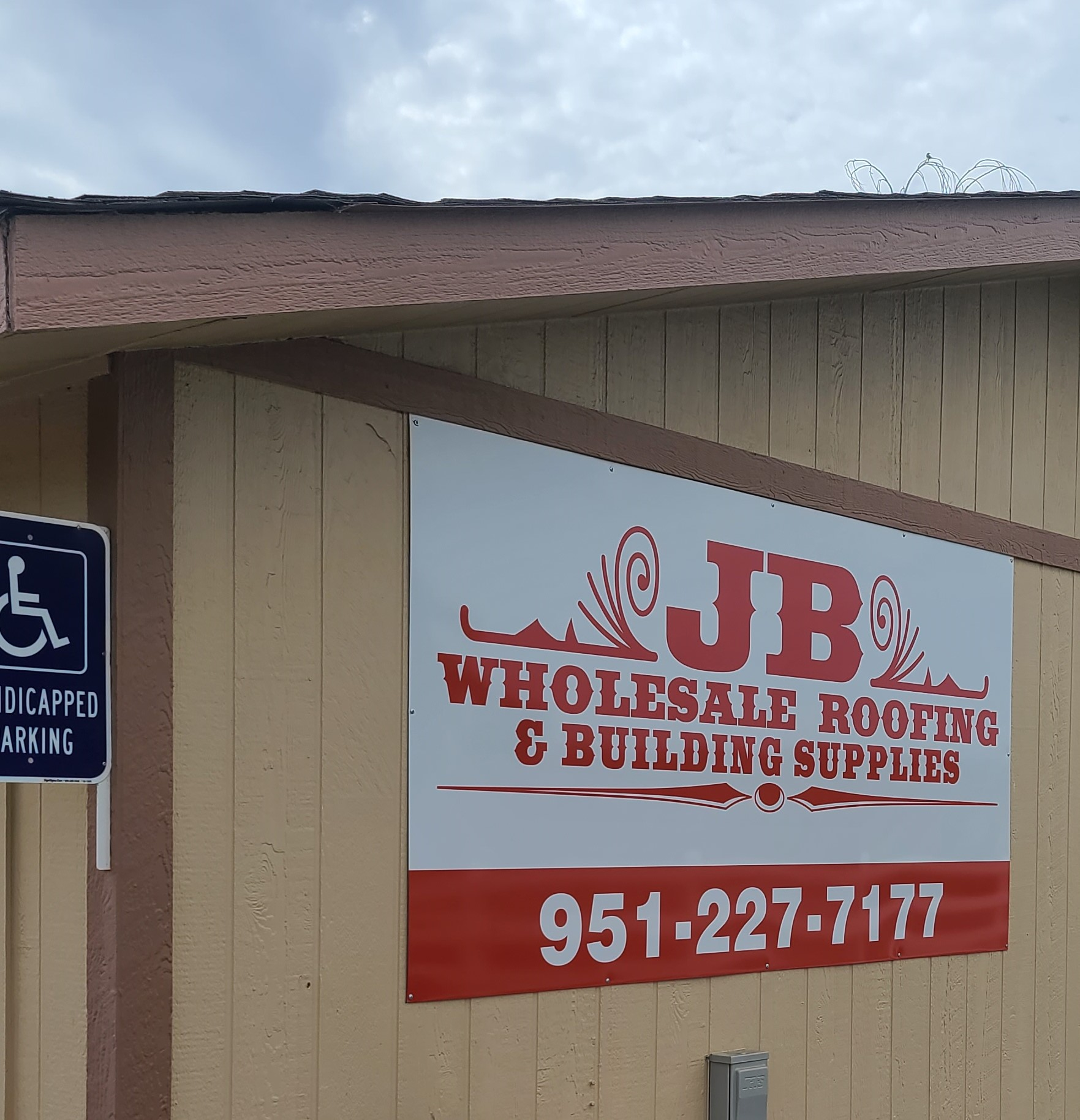 More from our sign package for JB Wholesale Roofing's Murrieta location, a metal panel building sign that displays their brand logo and its contact details.