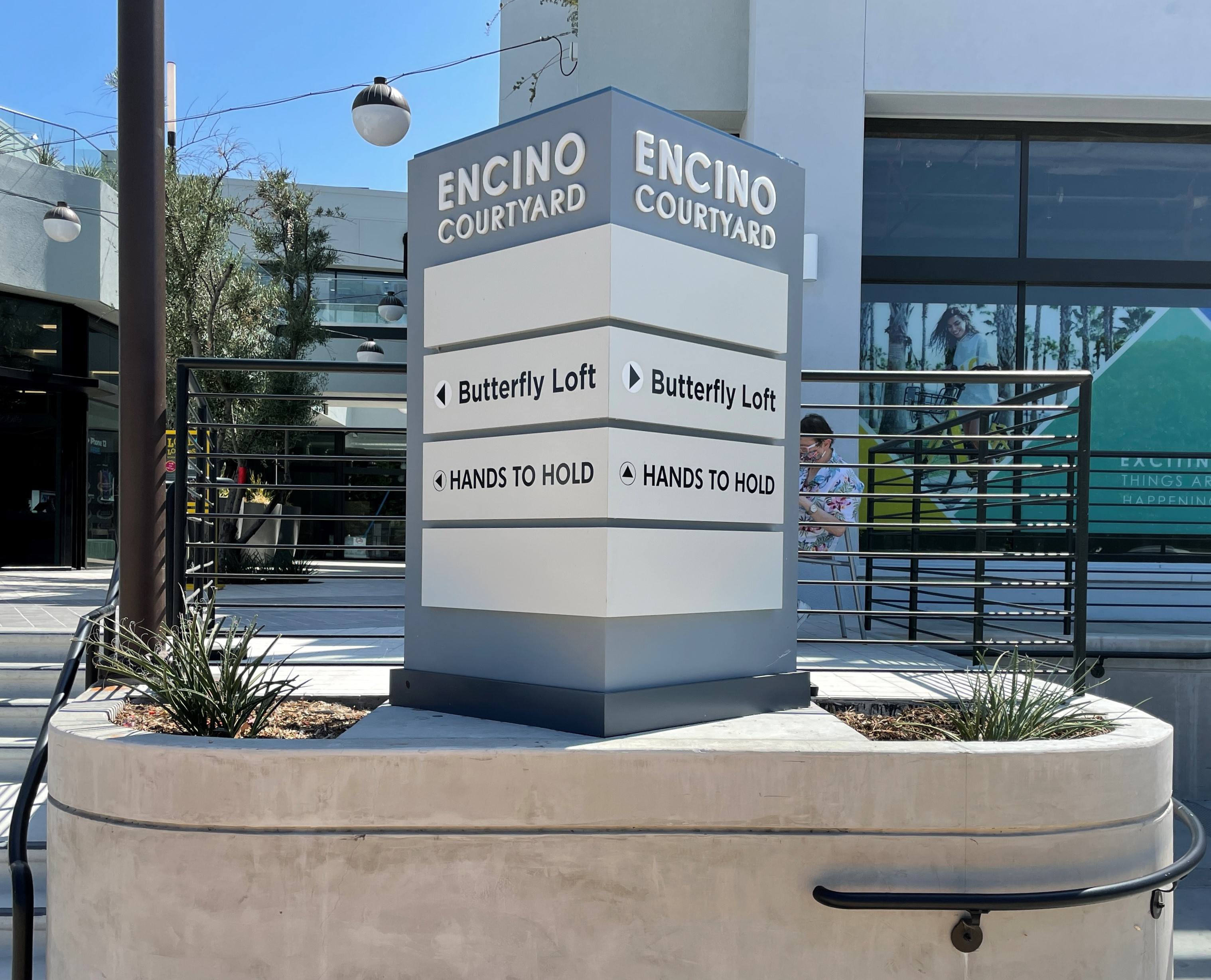 Businesses in commercial spaces can use outdoor wayfinding signs to guide customers. Like these signs for Hands to Hold's Encino Courtyard branch.