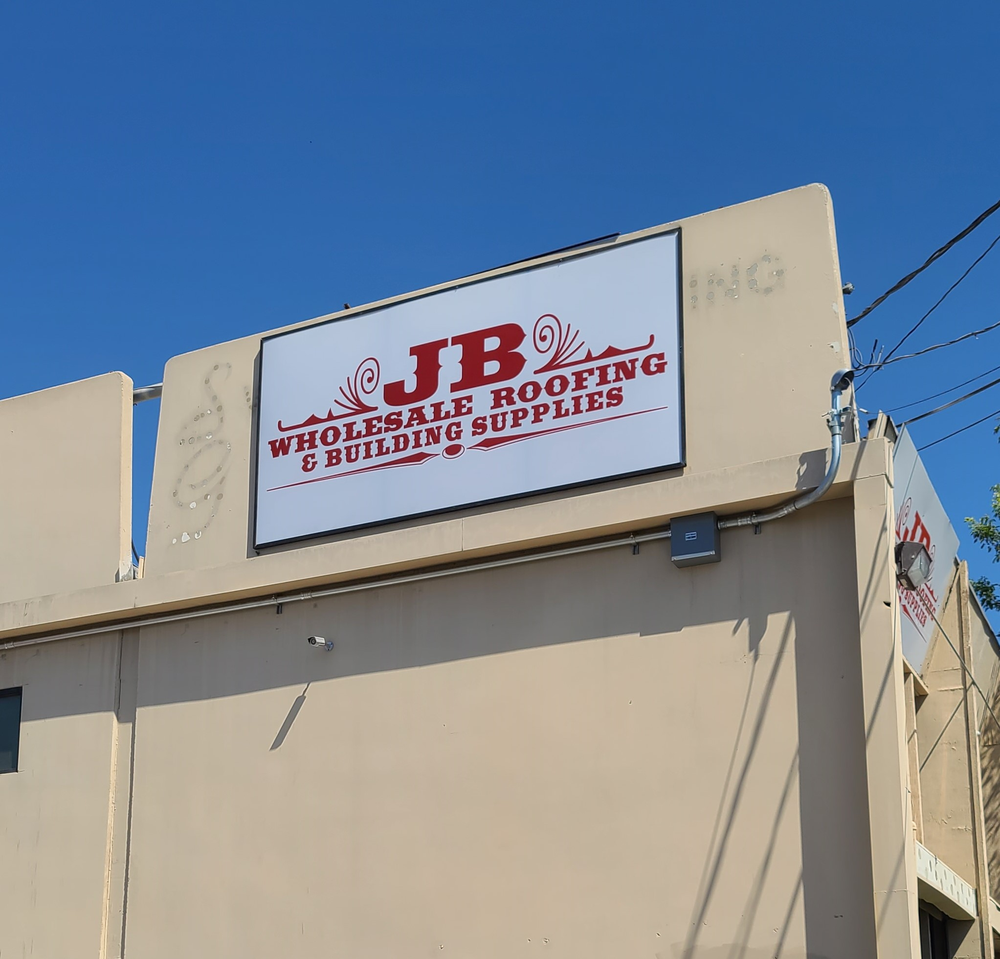 This is the building sign package we provided for JB Wholesale Roofing & Building Supplies branch.