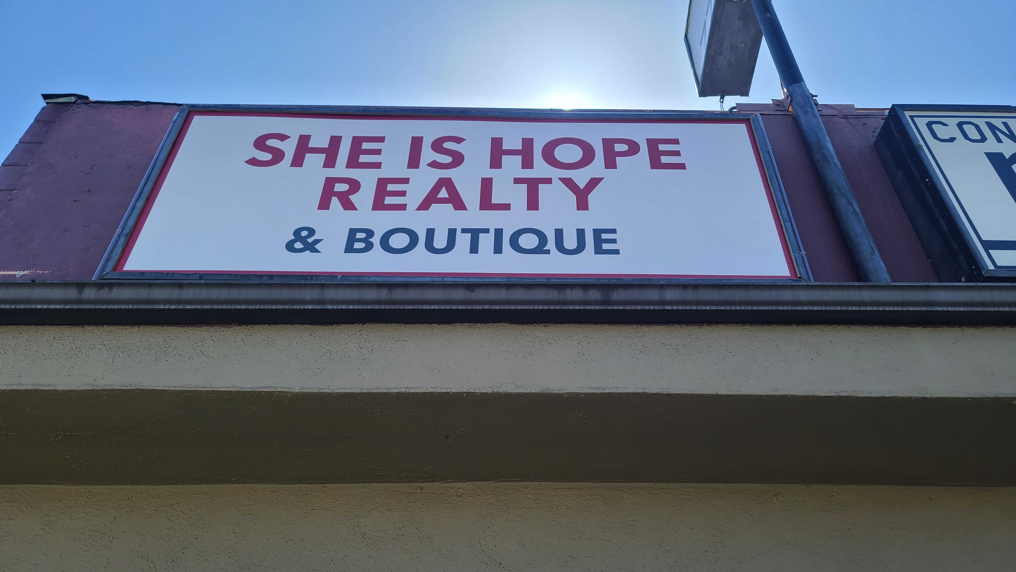 These lightbox inserts are part of storefront design package for She is Hope Realty & Boutique in Encino.